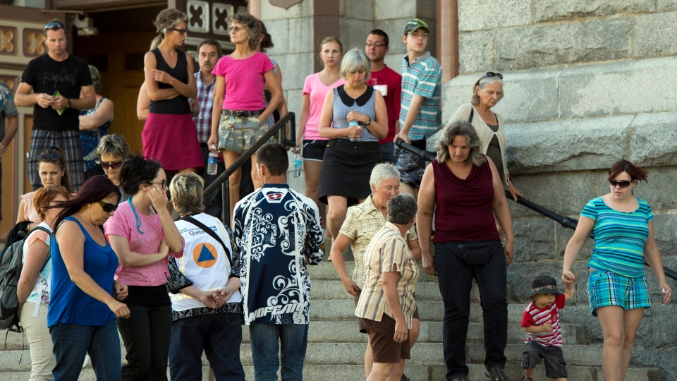 Families of the victims of the train derailment fire leave the church after seeing the crash site for the first time, Thursday, July 11, 2013 in Lac-Megantic, Que. (Ryan Remiorz / THE CANADIAN PRESS)