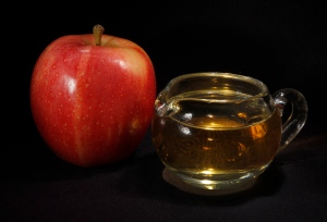 An apple and a pitcher of apple juice in Moreland Hills, Ohio.  (AP /Amy Sancetta)