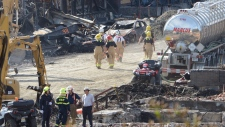 searching through rubble in lac-megantic