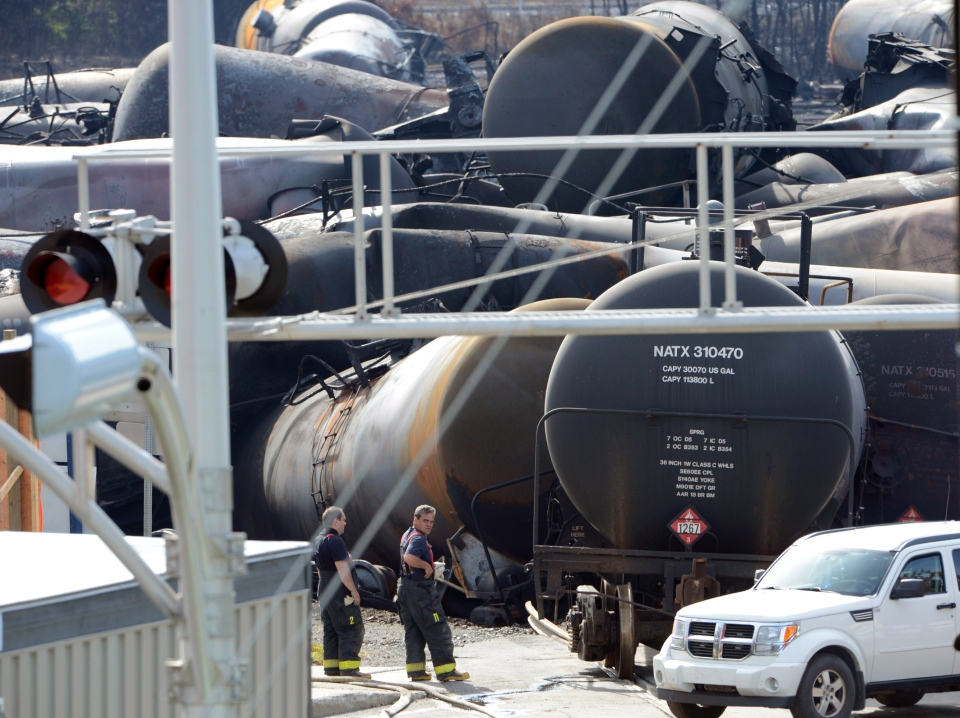 Crews work on the Lac-Megantic train derailment wreck on Friday, July 12, 2013. (Ryan Remiorz / THE CANADIAN PRESS)