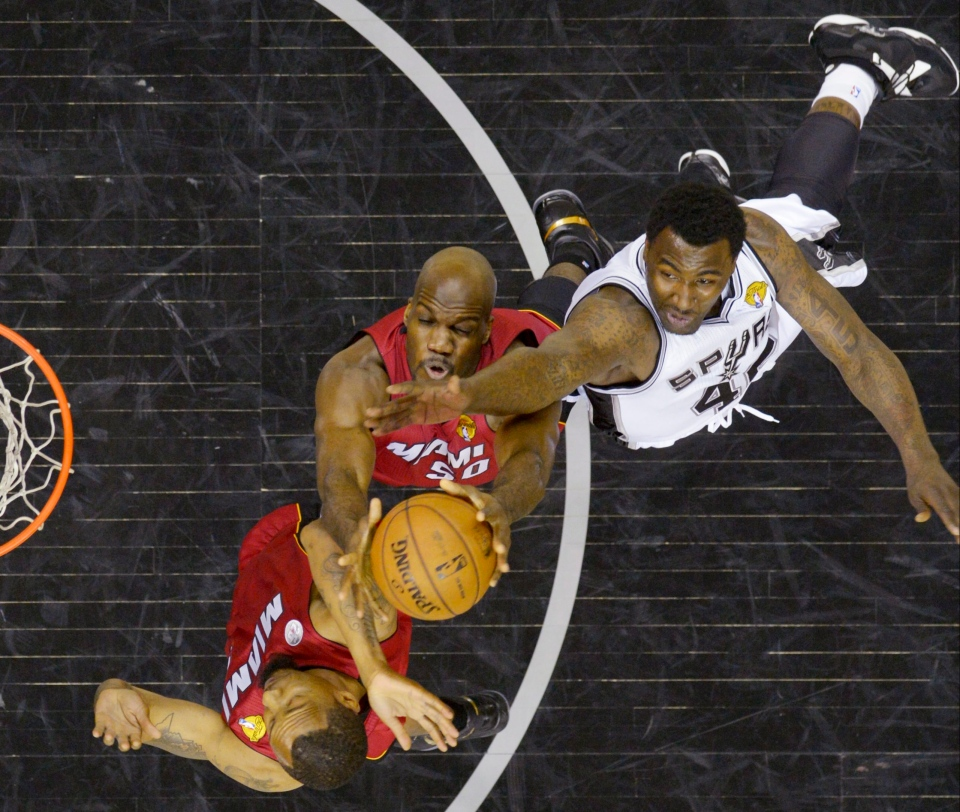 Miami Heat's Joel Anthony (50) and San Antonio Spurs' DeJuan Blair (45) battle for a rebound during the second half at Game 3 of the NBA Finals basketball series, Tuesday, June 11, 2013, in San Antonio. (AP Photo/Soobum Im, Pool)
