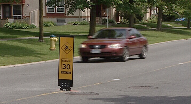 Traffic-calming sign