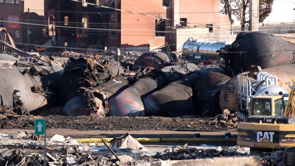 Charred tanker cars from the train crash scene in Lac-Megantic, Que., are shown on Friday, July 12, 2013. (Jacques Boissinot / THE CANADIAN PRESS)