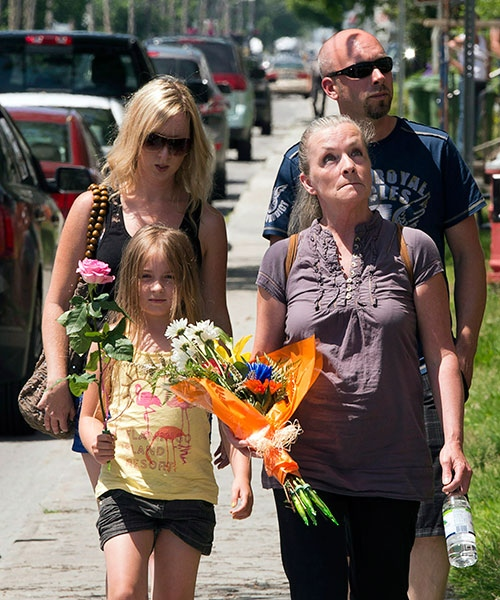 Residents arrive at Ste-Agnes church near the crash site after paying their respects in Lac-Megantic, Que., Friday, July 12, 2013. (Ryan Remiorz / THE CANADIAN PRESS)