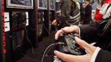 Visitors at the Sony Building in downtown Tokyo play on the Sony PlayStation 3, Nov. 9, 2006. (AP / Katsumi Kasahara)