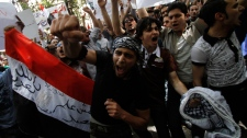 Syrian protesters chant angry slogans as they protest against the ongoing violence in Syria in front of the Syrian embassy in Cairo, Egypt, Tuesday, April 26, 2011. (AP / Khalil Hamra)