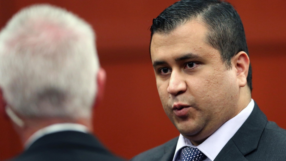 George Zimmerman, right, talks to court security investigator Robert Hemmert during a recess after a jury question in the 25th day of his trial at the Seminole County Criminal Justice Center, in Sanford, Fla., Saturday, July 13, 2013. (Orlando Sentinel, Joe Burbank)