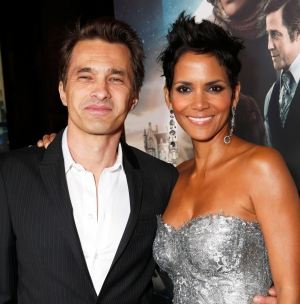 Actors Olivier Martinez, left, and Halle Berry at the Los Angeles premiere of Berry's film, 'Cloud Atlas,' in the Hollywood section of Los Angeles on  Oct. 24, 2012.  (Todd Williamson / Invision)
