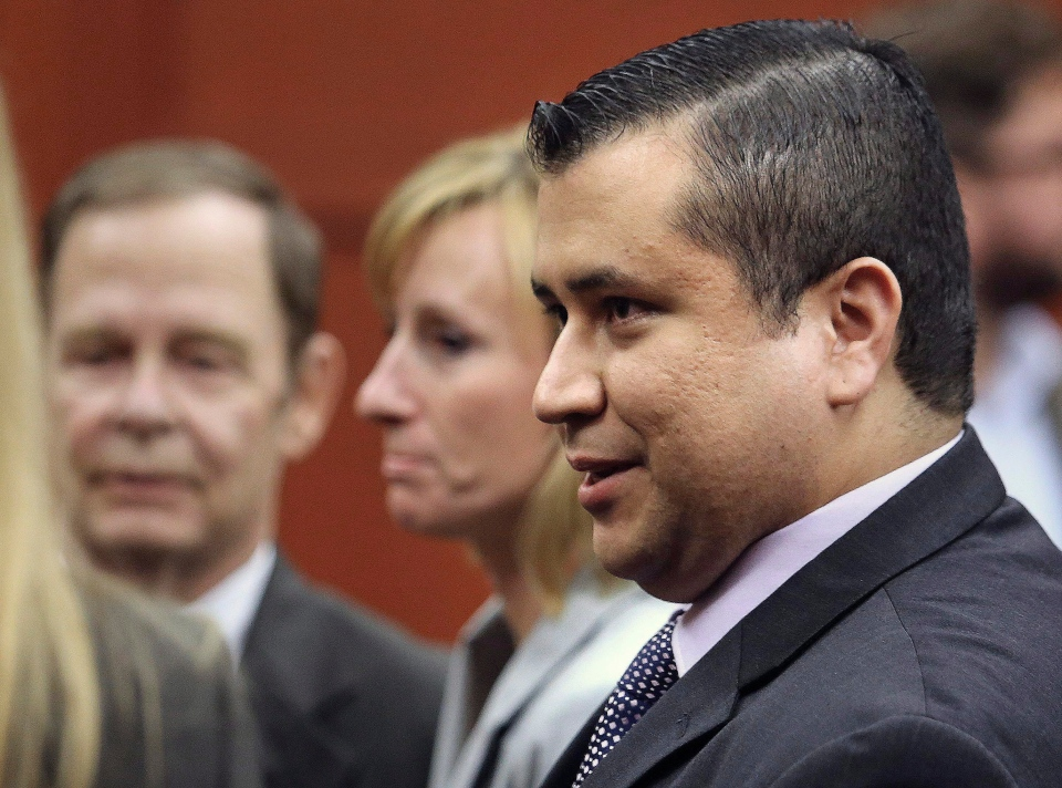 George Zimmerman leaves court with his family after Zimmerman's not guilty verdict was read in Seminole Circuit Court in Sanford, Fla. on Saturday, July 13, 2013. (AP / Joe Burbank)