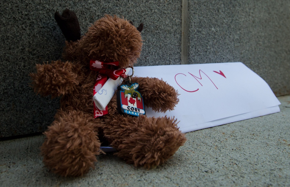 A stuffed moose and a note are placed at a small memorial for Canadian actor Cory Monteith outside the Fairmont Pacific Rim Hotel where he died Saturday, in Vancouver, B.C., on Sunday July 14, 2013. Monteith's body was found in a room at the hotel Saturday. (THE CANADIAN PRESS/Darryl Dyck)