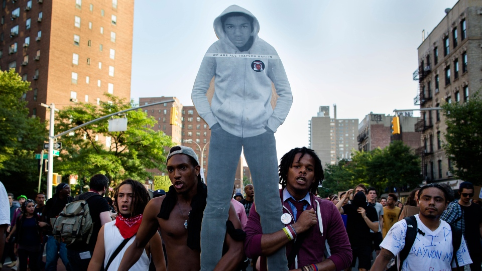 Demonstrators march through the Lower East Side neighborhood of Manhattan in New York holding a cut-out of Trayvon Martin during a protest against the acquittal of neighborhood watch member George Zimmerman in the killing of the 17-year-old in Florida, Sunday, July 14, 2013, in New York. (AP / John Minchillo)