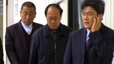 Qian Liu's family arrives at the Ontario Superior Court of Justice in Toronto, Tuesday, April 26, 2011.