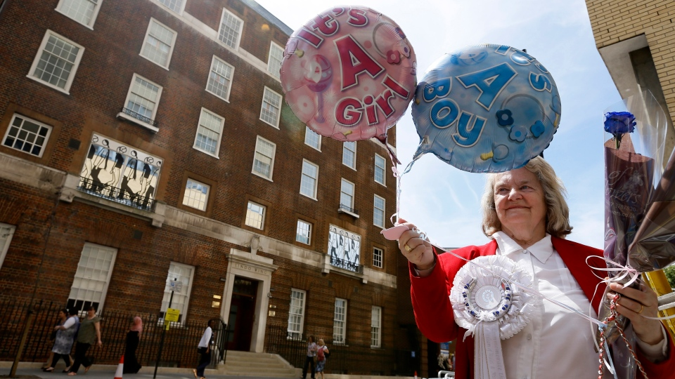 Royal supporter Margaret Tyler displays balloons for the media in front of the Lindo Wing at St Mary's Hospital in London, Monday, July 15, 2013. (AP / Kirsty Wigglesworth)