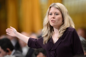 Conservative MP Michelle Rempel, a junior minister for western economic development, responds to a question in Ottawa on June 11, 2013. Rempel is one of several candidates who may be serving as a showcase of the leadership potential inside the Conservative party this election. (Sean Kilpatrick / THE CANADIAN PRESS)