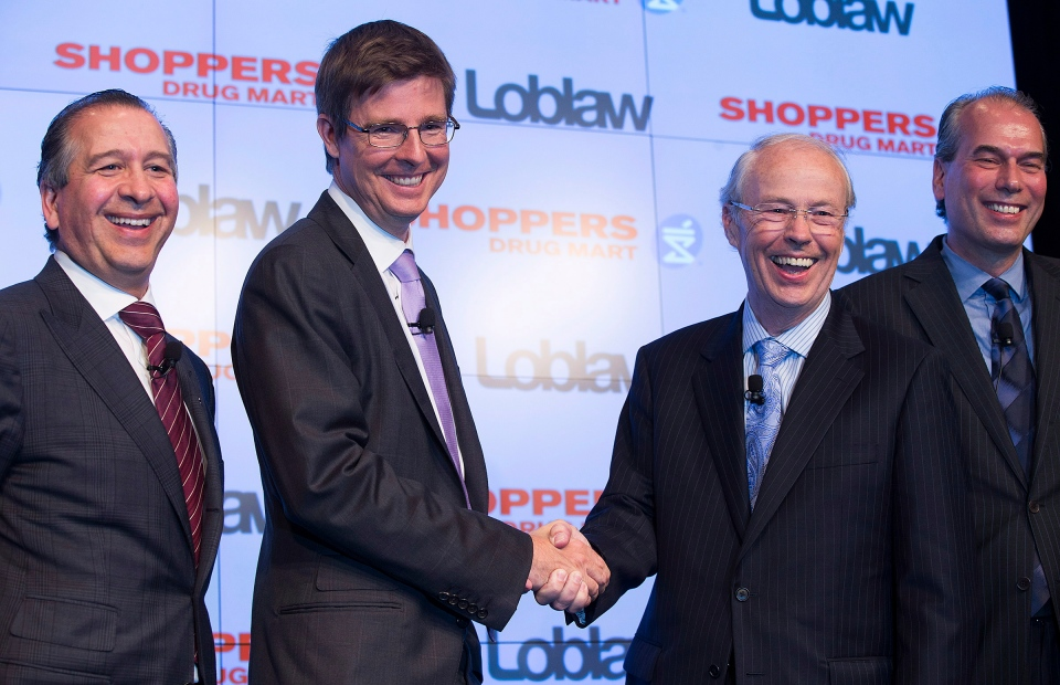 Domenic Pilla, president and CEO of Shoppers Drug Mart Corporation; left to right, along Galen Weston Jr., executive chairman of Loblaw Co. Ltd.; Holger Kluge, chair of Shoppers Drug Mart Corporation; and Vicente Trius president of Loblaw Co. Ltd., pose for a photo at a press conference announcing that Loblaw Companies Limited will acquire Shoppers Drug Mart Corporation for $12.4 billion in cash and stock in Toronto on Monday, July 15, 2013. (Michelle Siu / THE CANADIAN PRESS)