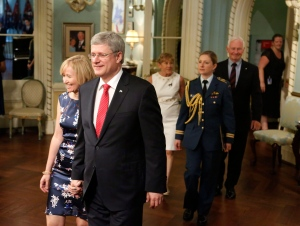 Prime Minister Stephen Harper and his wife Laureen arrive for the swearing in of the federal cabinet at Rideau Hall in Ottawa on Monday, July 15, 2013. (THE CANADIAN PRESS/Patrick Doyle)