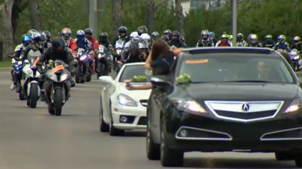 A procession of motorcycles makes its way down Memorial Drive to remember Brennan Kootnekoff.