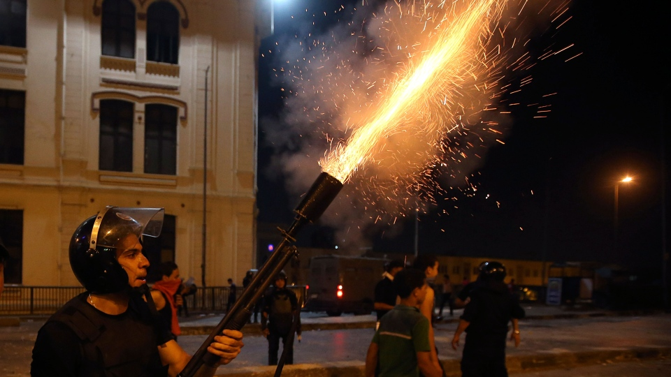 Egyptian security forces fire tear gas towards supporters of ousted President Mohammed Morsi during clashes in downtown Cairo, Egypt, Monday, July 15, 2013. (AP / Hussein Malla)