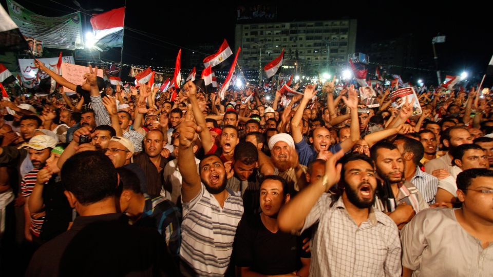 Supporters of Egypt's ousted President Mohammed Morsi shout slogans in Nasr City, a suburb of Cairo, Monday, July 15, 2013. (AP / Nasser Shiyoukhi)