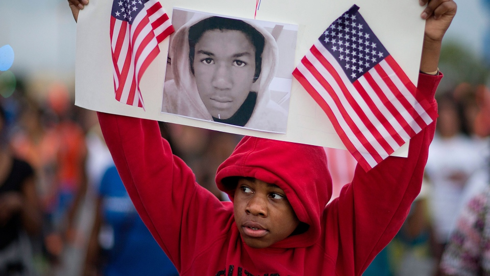 Jaylen Reese, 12, of Atlanta, marches to downtown during a protest of George Zimmerman's not guilty verdict in the 2012 shooting death of teenager Trayvon Martin, Monday, July 15, 2013, in Atlanta. (AP / David Goldman)