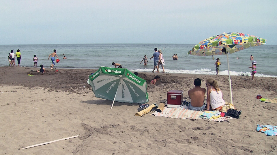 People cool off at Woodbine Beach in Toronto, Monday, July 15, 2013.