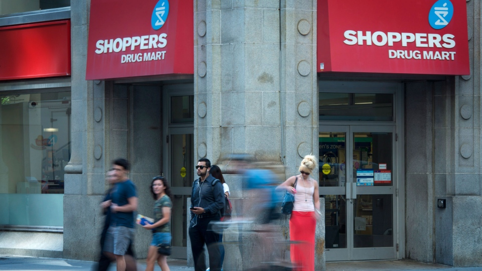 People pass by a Shoppers Drug Mart in downtown Toronto on Monday, July 15, 2013. (Graeme Roy / THE CANADIAN PRESS)