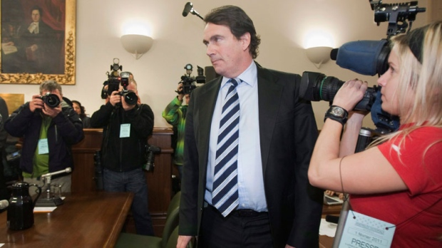 Pierre-Karl Peladeau, president of Quebecor, walks by media people to testify at a legislature committee on Labour 2011 at the legislature in Quebec City, Tuesday, February 1. (Jacques Boissinot / THE CANADIAN PRESS)