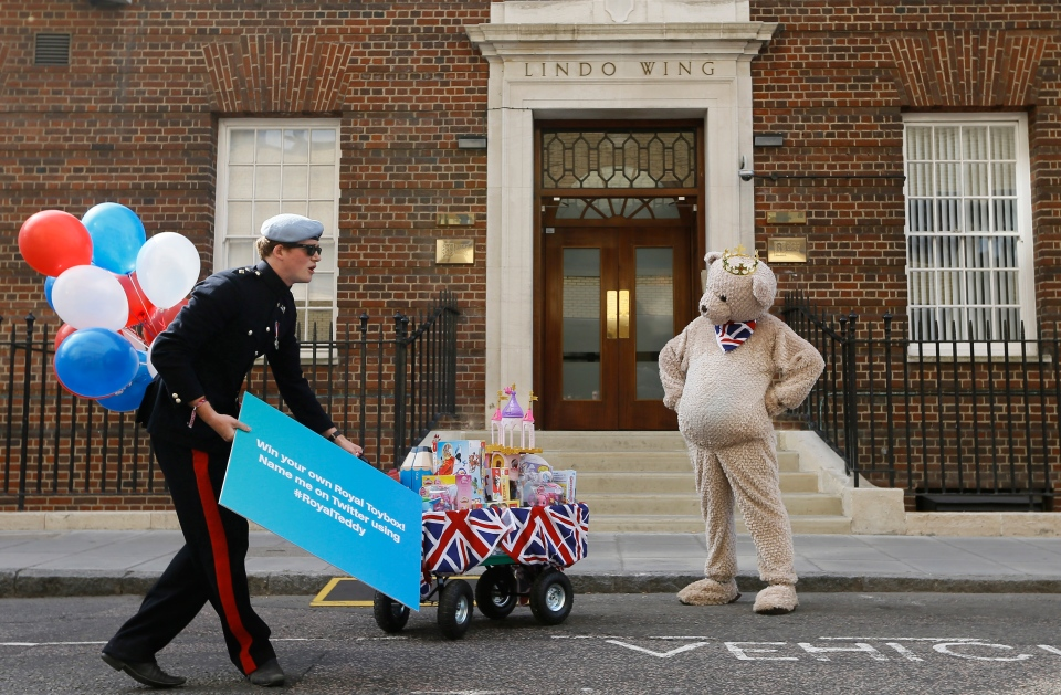 A Prince Harry lookalike turns up to donate toys to the hospital as a publicity stunt outside the Lindo Wing at St Mary's Hospital in London, Tuesday, July 16, 2013. (AP / Kirsty Wigglesworth)
