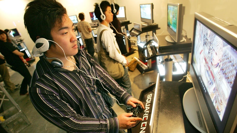 People play Sony PlayStation 3 consoles at the Square Enix Party, in Makuhari, near Tokyo, on May 13, 2007. (AP / Shizuo Kambayashi)