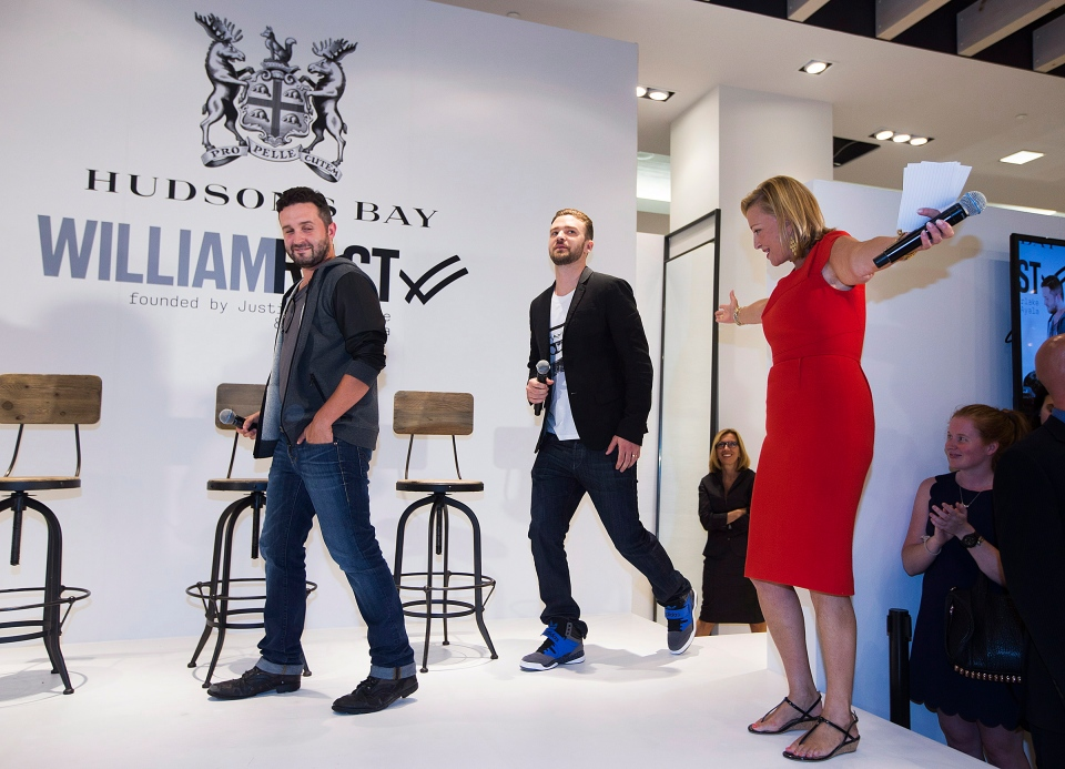 Hudson's Bay Co. vice-chair Bonnie Brooks, right, welcomes Justin Timberlake, centre, and Trace Ayala as they promote their William Rast clothing line in Toronto on Tuesday, July 16, 2013. (THE CANADIAN PRESS/Michelle Siu)
