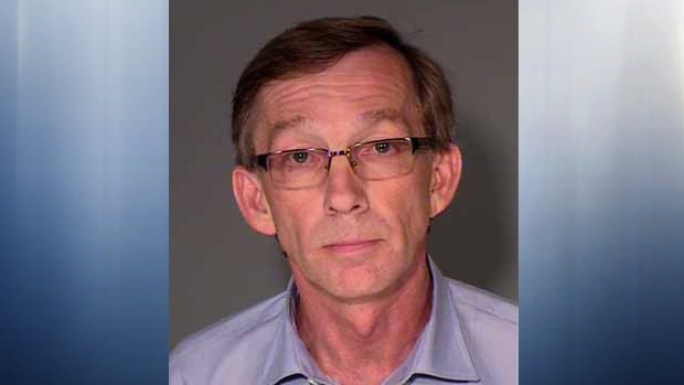 Fort McMurray MLA Mike Allen, in a booking photo dated Monday, July 15, 2013. (Ramsey County)