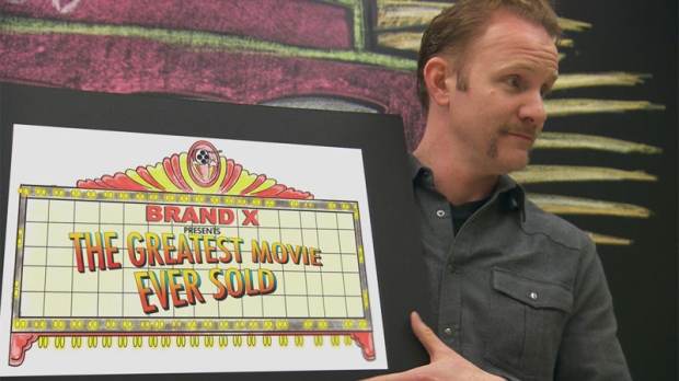 Director Morgan Spurlock holds a sign for his documentary 'Pom Wonderful Presents: The Greatest Story Ever Sold.'(Daniel Marracino / courtesy of Sony Pictures Classics)