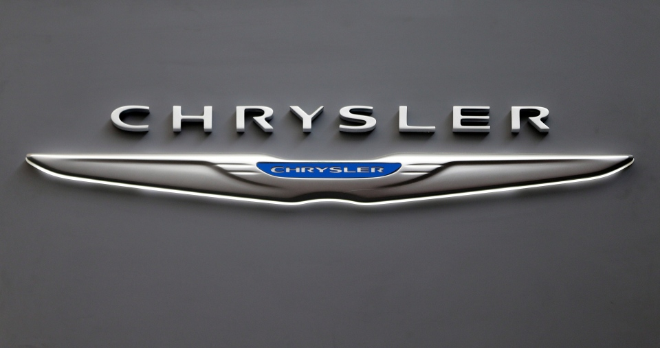 This Feb. 14, 2013 file photo shows the Chrysler logo on a sign at the 2013 Pittsburgh Auto Show in Pittsburgh. (AP / Gene J. Puskar, File)
