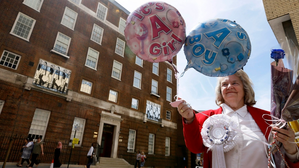 Royal supporter Margaret Tyler displays balloons for the media in front of the Lindo Wing at St Mary's Hospital in London, Monday, July 15, 2013. Britain's Kate, the Duchess of Cambridge plans to give birth to her first child who will be third-in-line to the throne at the hospital in mid-July. (AP / Kirsty Wigglesworth)