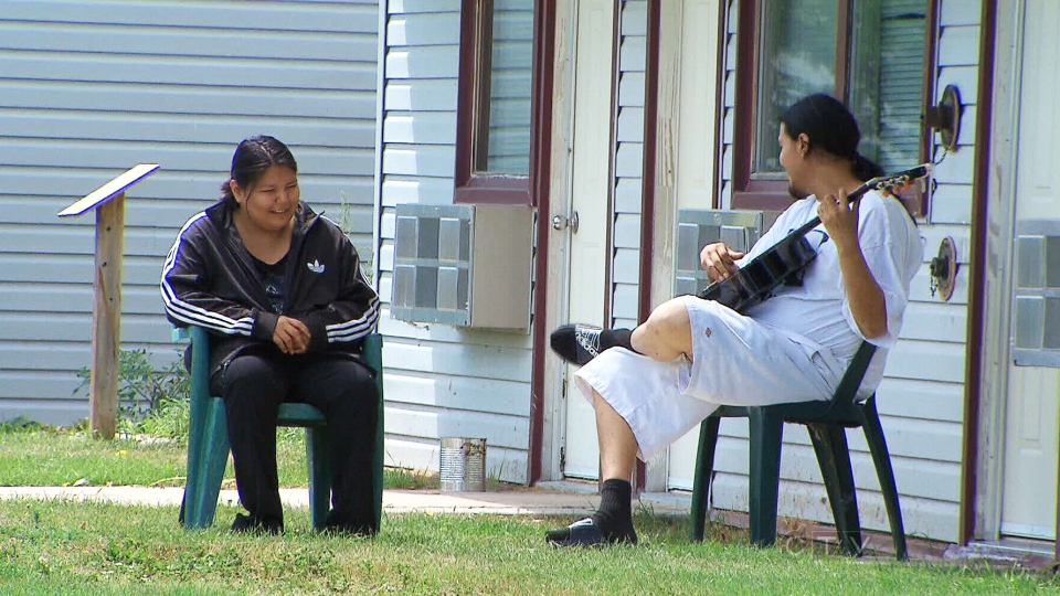 Former flood evacuees sit outside the Misty Lake Lodge in Gimli, Manitoba, Tuesday, July 16, 2013. (CTV National News)