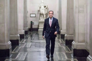 Mark Carney, the new Governor of the Bank of England, walks to a monetary policy committee (MPC) briefing on his first day on the job inside the central bank's headquarters in London Monday July 1, 2013. Carney is getting plaudits for suggesting images of women must be included on that country's new bank notes. (AP / Jason Alden)