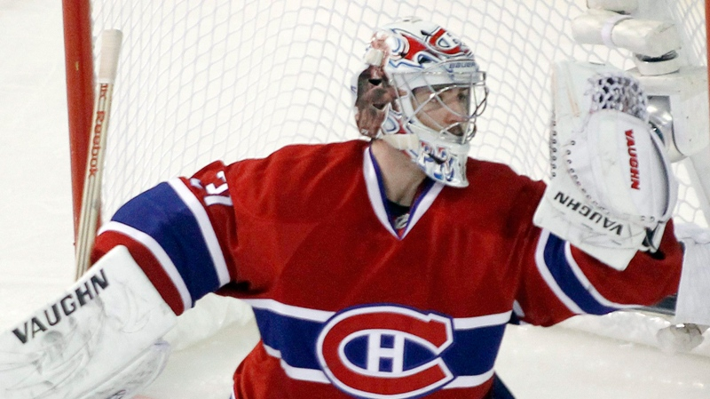 Montreal Canadiens goalie Carey Price makes a glove save on his way to defeating the Boston Bruins 2-1 in game six NHL Stanley Cup playoff hockey action Tuesday, April 26, 2011 in Montreal. (Ryan Remiorz / THE CANADIAN PRESS)