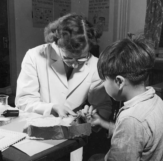 A nurse takes a blood sample from a boy at the Indian School, Port Alberni, B.C., in 1948, during the time when nutritional experiments were being conducted on students there and five other residential schools. (Library and Archives Canada)