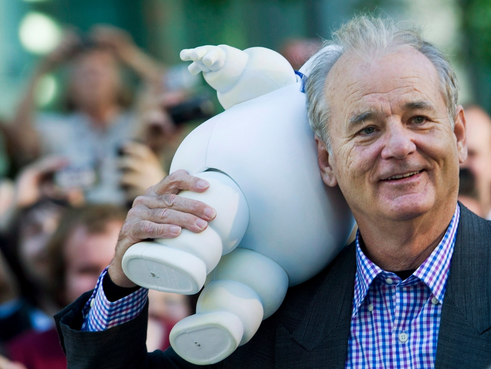 Actor Bill Murray walks with the Marshmallow Man from his 1980's box office hit movie Ghostbusters during the 37th annual Toronto International Film Festival in Toronto on Monday, Sept. 10, 2012. ( Nathan Denette / THE CANADIAN PRESS)