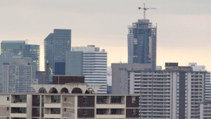 A construction crane sits atop a highrise in Toronto on Saturday, Feb. 4, 2012. (The Canadian Press/Pawel Dwulit)