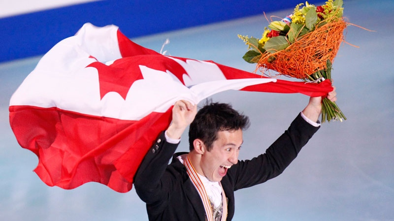 Gold medalist Canada's Patrick Chan skates with the national flag after free program at the ISU Figure Skating World championships in Moscow, Russia, Thursday, April 28, 2011. (AP / Misha Japaridze)