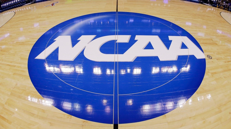 In this March 21, 2013, file photo, in this image taken with a fisheye lens, the NCAA logo is displayed at mid-court before Albany's practice for a second-round game of the NCAA college basketball tournament in Philadelphia. (AP Photo/Matt Slocum)