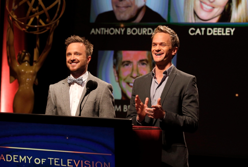 Actors Aaron Paul, left, and Neil Patrick Harris announce nominations at the 65th Primetime Emmy Nominations Announcements at the Leonard H. Goldenson Theatre at the Academy of Television Arts & Sciences, Thursday, July 18, 2013, in North Hollywood, California. (Todd Williamson / Invision)