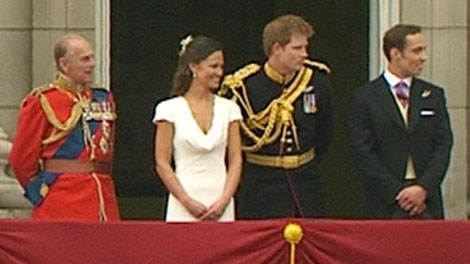 Best man Prince Harry and maid of honour Pippa Middleton stand on the balcony of Buckingham Palace with other royals after the royal Wedding in London on Friday, April, 29, 2011.
