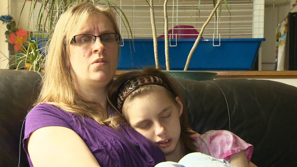 Paula Janfield, shown with sleeping daughter Teigan, says not one of the 14 medications prescribed have stopped Teigan's seizures.