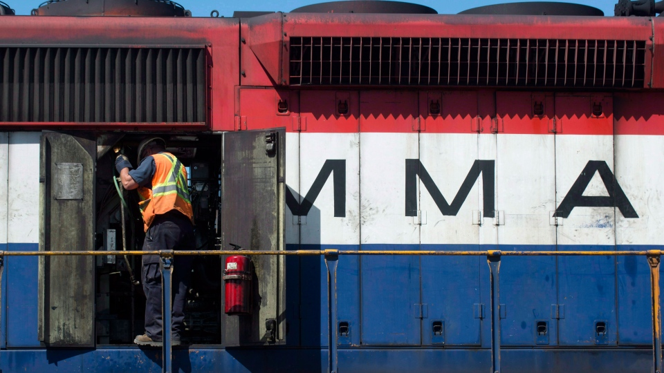 An engineer checks the engine of a Montreal Maine and Atlantic locomotive outside the offices of MMA railway in the town of Farnham, Que., on July 11, 2013. (Graham Hughes / THE CANADIAN PRESS)