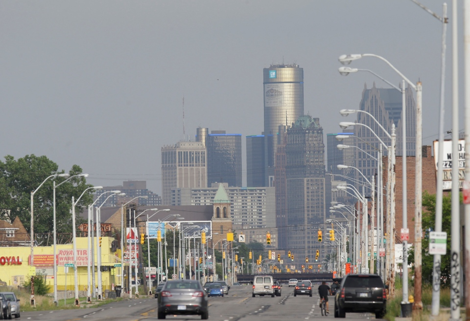 The Detroit skyline is seen from Grand River on Thursday, July 18, 2013. (AP / Carlos Osorio)