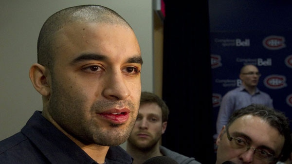 Montreal Canadiens center Scott Gomez speaks to reporters at the end of season media availability Thursday, April 28, 2011 in Brossard, Que., after losing their NHL Stanley Cup playoff first round series to the Boston Bruins in seven gamesl.THE CANADIAN PRESS/Ryan Remiorz