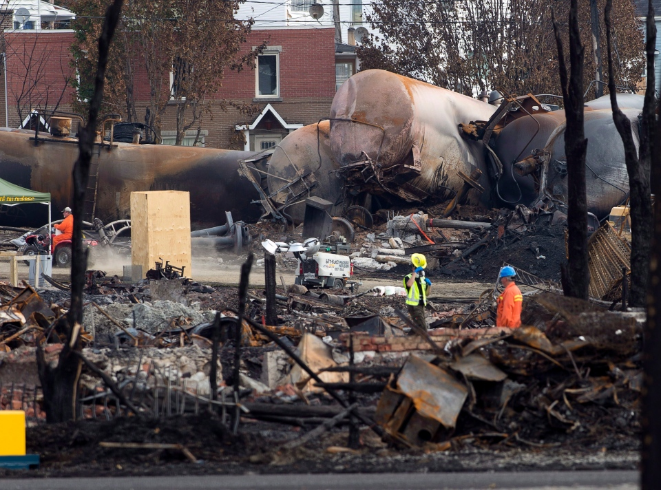 Work continues at the crash site of the train derailment and fire, in Lac-Megantic, Que., Tuesday, July 16, 2013. (Ryan Remiorz / THE CANADIAN PRESS)