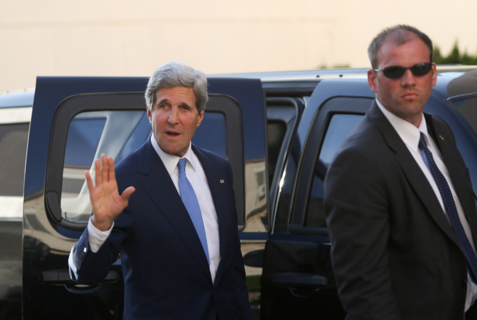 U.S. Secretary of State John Kerry waves to media as he arrives for a meeting with Palestinian President Mahmoud Abbas in the West Bank city of Ramallah on Friday, July 19, 2013. (AP / Fadi Arouri)